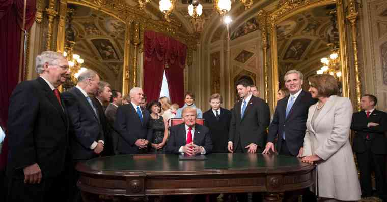 President Donald Trump is joined by the Congressional leadership and his family as he formally signs his cabinet nominations into law, in the President's Room of the Senate, at the Capitol in Washington, Friday, Jan. 20, 2017. (AP Photo/Scott Applewhite, Pool)